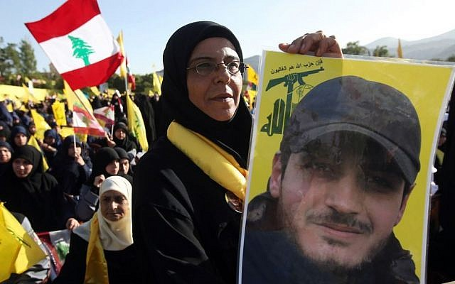 A Hezbollah supporter holds a portrait of her son, Ibrahim Kanso, 24, who was killed 40 days before, at Sayida Zeinab shrine during a battle in Syria against the Syrian rebels, May 24 (AP Photo/Hussein Malla)