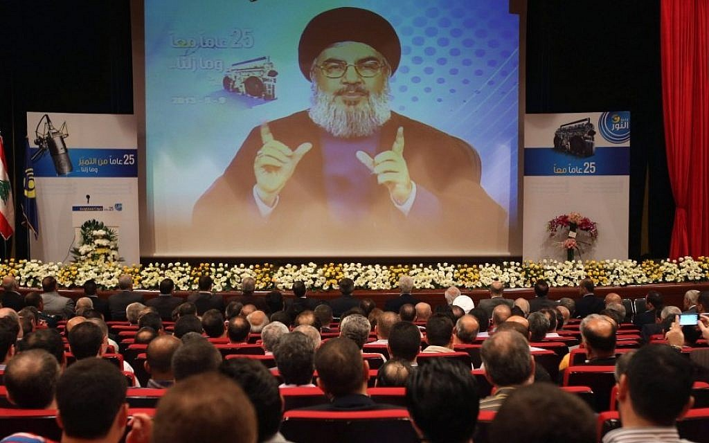 Hezbollah leader Sheik Hassan Nasrallah speaks via video during a conference, held in a southern suburb of Beirut, Lebanon, early May. (photo credit: AP/Hussein Malla)