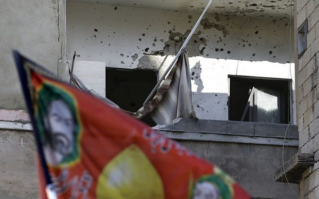 A house in Beirut hit by rockets Sunday (photo credit: Hussein Malla/AP)
