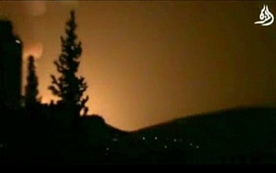 Smoke and fire fill the skyline over Damascus, Syria, early Sunday, May 5, 2013 after a reported Israeli airstrike. (AP Photo/Shaam News Network via AP video)
