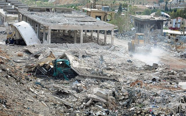 Illustrative image released by the Syrian official news agency SANA shows a general view of damaged buildings wrecked by an Israeli airstrike, in Damascus, Syria, Sunday, May 5, 2013.  (AP/SANA)