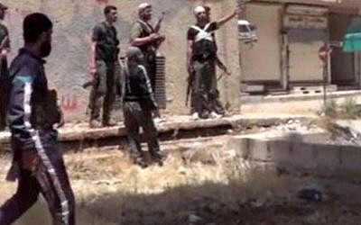 Rebel fighters in Daraa, Syria, on Tuesday, May 28, 2013 (photo credit: AP Photo/Ugarit News via AP video)