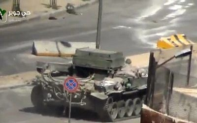 A Syrian Army tank in the streets of Damascus, Syria, Friday, April 26, 2013. (photo credit: AP/Ugarit via AP video)