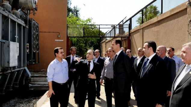 Syrian President Bashar Assad, center, visits the Umayyad Electrical Station on May Day, a day after a powerful bomb hit the capital. in Damascus, Syria, Wednesday, May 1 (photo credit: AP/SANA)
