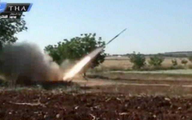 A rocket fired by Syrian rebels in Qusair, Syria, May 28 (photo credit: Ugarit news/AP)