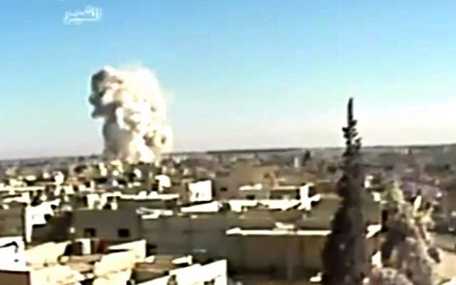This image made from video shows an explosion from shelling in Qusair, Syria, in late May (photo credit: AP/Ugarit News)