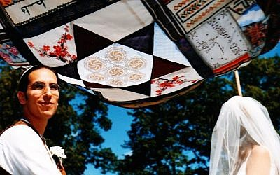 Ned Lazarus and Nahanni Rous standing under the chuppah made from the fabric sheets brought by their guests, 2004. (photo credit: Courtesy Nahanni Rous/JTA)