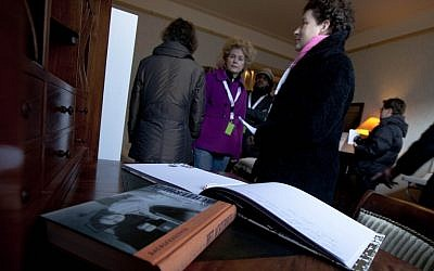 Anne Frank's diary is seen on her writing desk as visitors tour the first house of Anne Frank in Amsterdam, Netherlands, where the Frank family lived from 1933 to 1942. (photo credit: AP Photo/Peter Dejong, File)