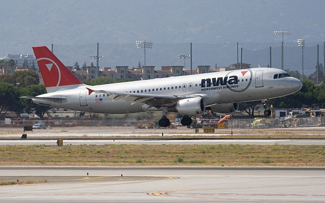 Northwest Airlines A320 upon takeoff in San Jose, California, 2007. (photo credit: Dylan Ashe, CC, via wikipedia)