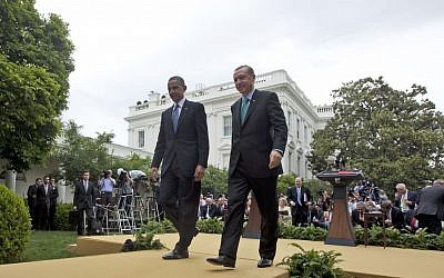 US President Barack Obama and Turkish Prime Minister Recep Tayyip Erdogan walk away from the podiums following their joint news conference in the Rose Garden of the White House in Washington, Thursday, May 16. (photo credit: AP/Pablo Martinez Monsivais)