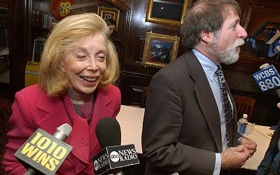 "Dr. Joyce Brothers, left, and Bruce Spizer, author of ""The Beatles are Coming,"" being interviewed at a news conference in New York in 2004. (photo credit: AP/Richard Drew, File)"