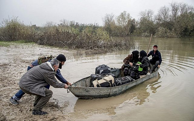 Rebel troops transporting two women to safety along the Orontes River, which has shrunk in recent years and grown increasingly saline (Photo credit: CC BY FreedomHouse)