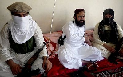 Taliban No 2 commander Waliur Rehman, center, talks to the Associated Press during an interview in Shawal area of South Waziristan along the Afghanistan border in Pakistan, in July 2011. (photo credit: AP Photo/Ishtiaq Mahsud, File)