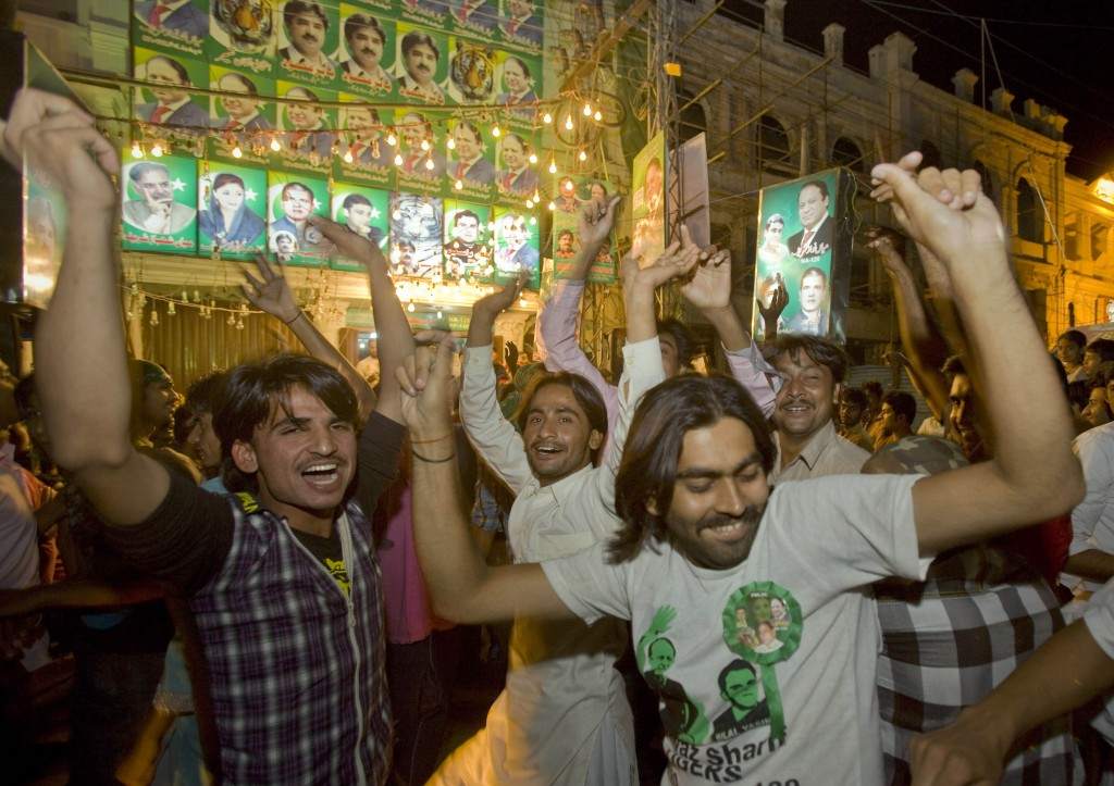 Supporters of Pakistan Muslim League-N party celebrate the primary unofficial results of the country's parliamentary elections at a party office in Lahore, Pakistan, Saturday, May 11, 2013 (photo credit: AP/Anjum Naveed)