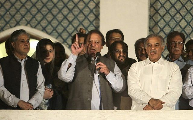 Former prime minister and leader of the Pakistan Muslim League-N party Nawaz Sharif, center, addresses his supporters as his brother Shahbaz Sharif, right, and daughter Maryam Nawaz, second from left, listen at a party office in Lahore, Pakistan, Saturday, May 11, 2013 (photo credit: AP/K.M. Chaudary)