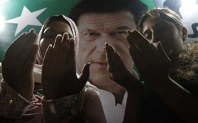 Supporters of Pakistan's cricket star-turned-politician Imran Khan pray for their leader's health in Karachi, Pakistan on Tuesday, May 7, 2013. One of Pakistan's most prominent politicians, Khan fell from a stage at a political rally Tuesday in Lahore, leaving him with two hairline skull fractures and uncertainty hanging over his ability to campaign ahead of Saturday's general election. (AP Photo/Shakil Adil)