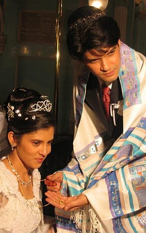 David Mapgaonkar puts a mangalsutra on Aviva during their wedding ceremony in 2004. (photo credit: Paul Dharamraj and Ofira Reuben/Times of Israel)
