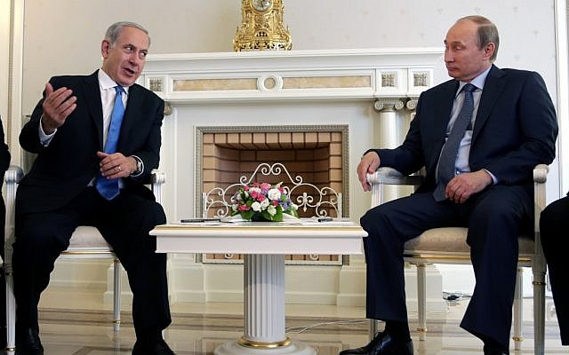 Russian President Vladimir Putin, right, listens to Israeli Prime Minister Benjamin Netanyahu during their meeting at the Bocharov Ruchei residence in the Black Sea resort of Sochi, Russia, Tuesday, May 14, 2013. (photo credit: AP/ Maxim Shipenkov)