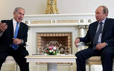 Russian President Vladimir Putin, right, listens to Israeli Prime Minister Benjamin Netanyahu during their meeting at the Bocharov Ruchei residence in the Black Sea resort of Sochi, Russia, Tuesday, May 14, 2013. (photo credit: AP/ Maxim Shipenkov)
