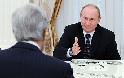 US Secretary of State John Kerry (back to camera) speaks to Russian President Vladimir Putin during their meeting in the Kremlin in Moscow, Tuesday, May 7, 2013. (photo credit: AP)