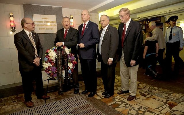 From left, US Congressmen, Steve Cohen (D-Tenn.), Dana Rohrabacher (R-Calif.), Bill Keating (D-Mass.), Steve King (R-Iowa.) and Paul Cook (R-Calif) lay a wreath at the site of a terrorist attack in 2000 in the underground street passage in Pushkin Square in downtown Moscow, on Wednesday, May 29, 2013. (AP Photo/Ivan Sekretarev)