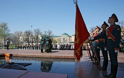Russian President Vladimir Putin, in the background, takes part in a wreath laying ceremony at the Tomb of Unknown Soldier on the eve of the Victory Day in Moscow, Wednesday, May 8, 2013. (photo credit: AP Photo/RIA-Novosti, Yekaterina Shtukina, Government Press Service)