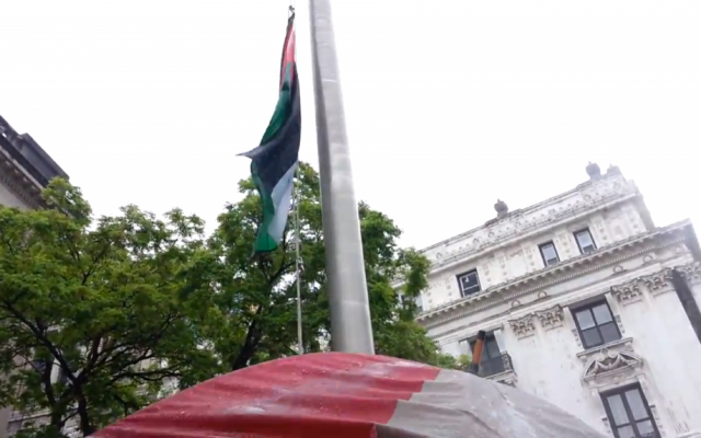 Palestinian-Americans run up the Palestinian flag at Paterson, NJ City Hall on May 20, 2013. (photo credit: image capture from YouTube video uploaded by westbank04)