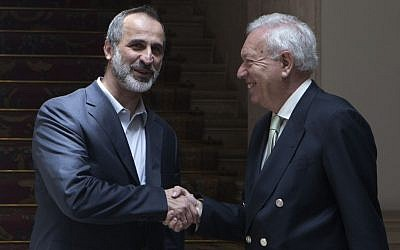 Syrian opposition leader Mouaz al-Khatib (left), shakes hands with Spain's Foreign Minister Jose Manuel Garcia-Margallo in Madrid on Tuesday May 21, 2013. (photo credit: AP/Paul White)