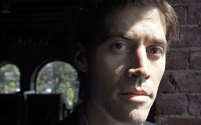 In this May 27, 2011, file photo, American journalist James Foley of Rochester, NH, poses for a photo in Boston. (photo credit: AP/Steven Senne)