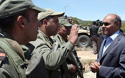 Tunisian President Moncef Marzouki visiting military officers in Jebel Chaambi, western Tunisia, close to the Algerian border, Tuesday, May 7, 2013 (photo credit: Tunisian Presidency/AP)
