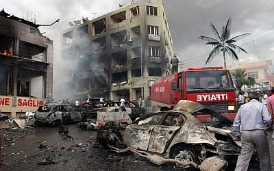 The site of one of the explosions that killed at least 40 people and injured dozens in Reyhanli, near Turkey's border with Syria, Saturday, May 11, 2013. (AP Photo/IHA)