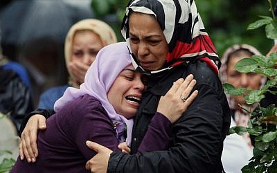 Mourning relatives during the burial of one of the 46 victims killed in Saturday explosions in Reyhanli, near Turkey's border with Syria, Sunday, May 12, 2013. (photo credit: AP/Burhan Ozbilici)