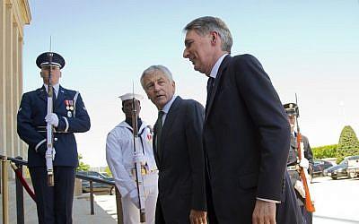 US Defense Secretary Chuck Hagel escorts British Defense Secretary Philip Hammond into the Pentagon, Thursday, May 2. (photo credit: AP/J. Scott Applewhite)