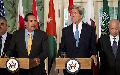 US Secretary of State John Kerry, second from right, with the Arab League lead by Qatar's Prime Minister and Foreign Minister Hamad bin Jassim bin Jabr Al-Thani, second from left, and Arab League Secretary-General Nabil Elaraby speaks to the media following their meeting at Blair House in Washington, Monday, April 29 (photo credit: AP/Manuel Balce Ceneta)