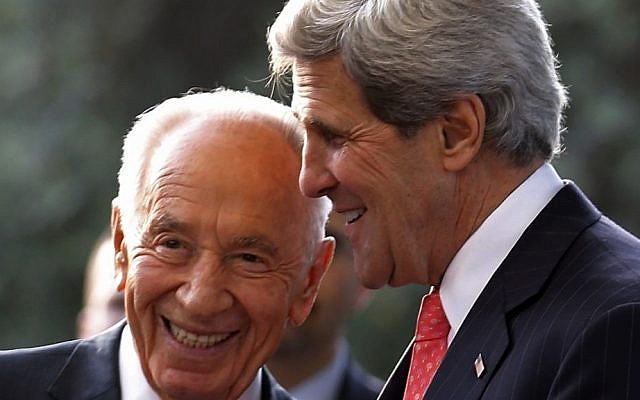 US Secretary of State John Kerry, right, meets with Israeli President Shimon Peres in Jerusalem on Thursday (photo credit: AP/Jim Young)