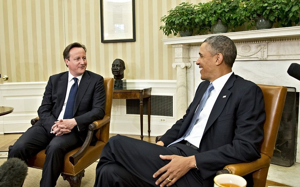 US President Barack Obama  welcomes British Prime Minister David Cameron in the Oval Office in May 2013. (photo credit: AP/J. Scott Applewhite)