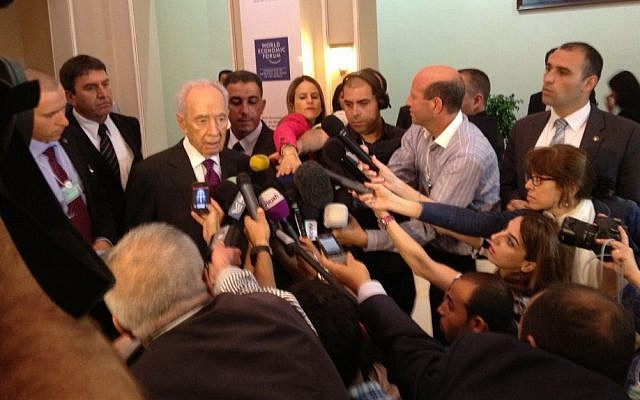 President Shimon Peres speaks to reporters at the World Economic Forum in Jordan, Sunday (photo credit: Raphael Ahren/Times of Israel)