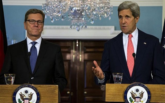 Secretary of State John Kerry, right, gestures as he speaks during a news conference with German Foreign Minister Guido Westerwelle at the State Department in Washington, Friday, May 31, 2013. (photo credit: AP/Evan Vucci)