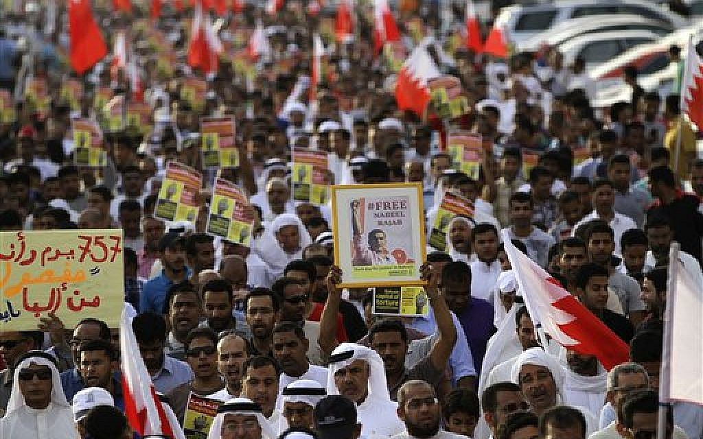 Bahraini anti-government protesters chant slogans and hold banners during a march in Daih, Bahrain, Friday, May 10, 2013.  (photo credit: AP Photo/Hasan Jamali)