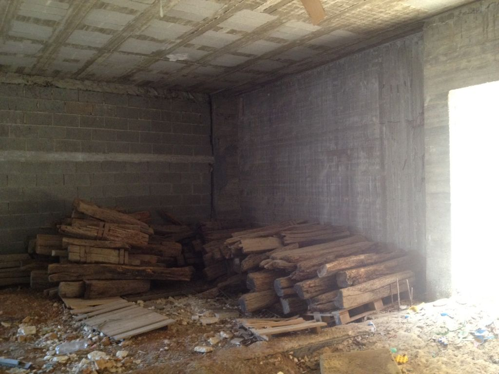 Beams in a storeroom at Ofra, this week (photo credit: Matti Friedman/Times of Israel)