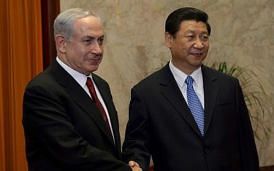 Prime Minister Benjamin Netanyahu and China's President Xi Jinping shake hands, May 9, 2013. (photo credit: Avi Ohayon/Flash90)