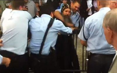 Coptic priest Father Arsanios struggles with several Israeli policemen in Jerusalem's Old City, on May 4, 2013. (photo credit: YouTube/Maariv)