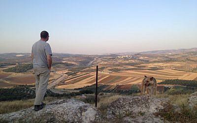 Dror Etkes, left, and Herzl, along the Green Line (photo credit: Matti Friedman/Times of Israel)