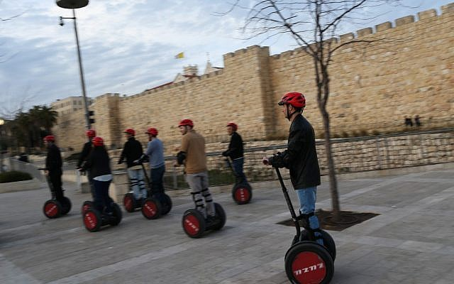Tourists ride Segways near the walls of Jerusalem's Old City, March 7, 2013 (photo credit: Nati Shohat/Flash)