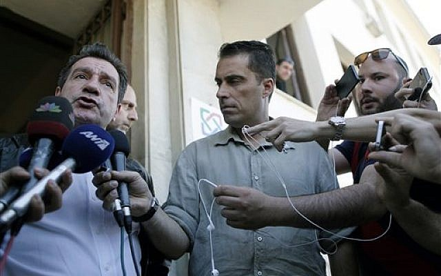 Athens' Mayor Giorgos Kaminis, left, is planning to ban a 'racist' Golden Dawn event. (photo credit: AP Photo/Petros Giannakouris)