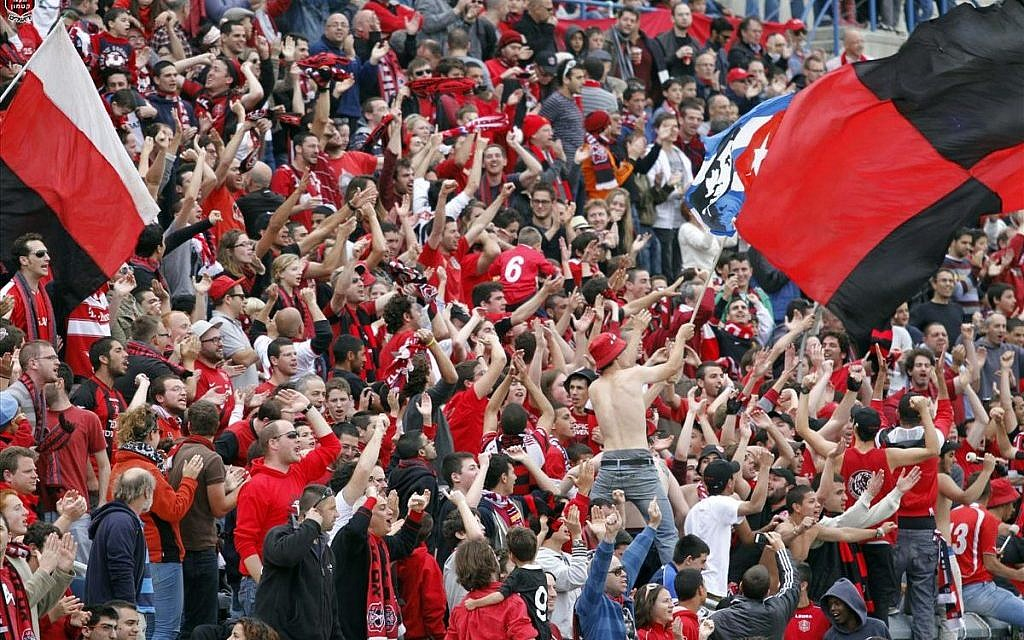 Passionate Hapoel Katamon Jerusalem fans at a game earlier this season (photo credit: Guy Yitzhaki, Hapoel Katamon Jerusalem's website; katamon.co.il)