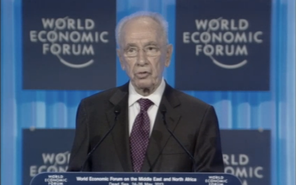 President Shimon Peres speaks at the World Economic Forum in Jordan on May 26, 2013. (photo credit: image capture/WEF video feed)