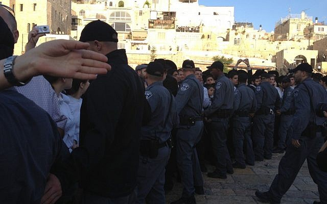 Border Police barricade part of the Western Wall plaza Friday morning as Women of the Wall make their way to the Jewish site to hold prayers on the first of the month of Sivan. (photo credit: Michal Shmulovich/Times of Israel staff)