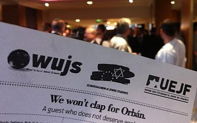 'We won't clap for Orban' leaflets, the WJC, Sunday (photo credit: Aaron Kalman/TimesofIsrael)