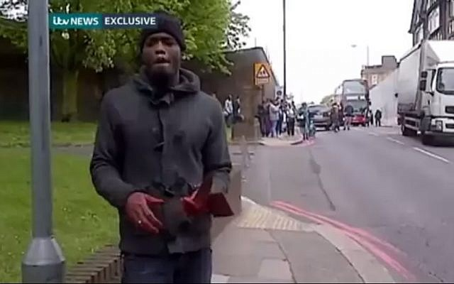 Michael Adebolajo speaks to a cameraman shortly after attacking and killing Lee Rigby, last May (photo credit: YouTube screenshot)